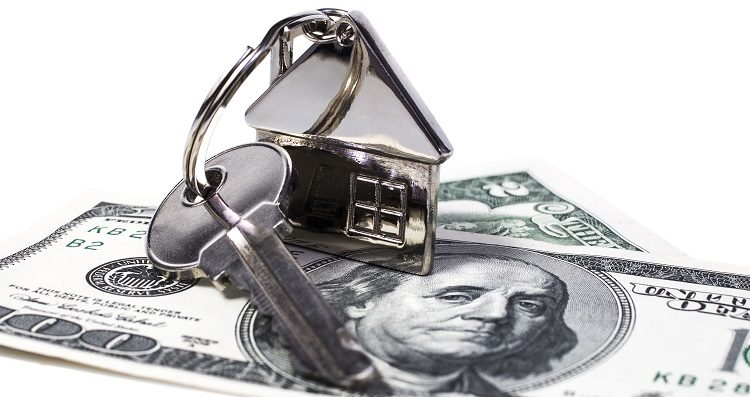 American dollars image, which is the key with remote control in the form of the house,  represents the purchase or sale  real estate and housing